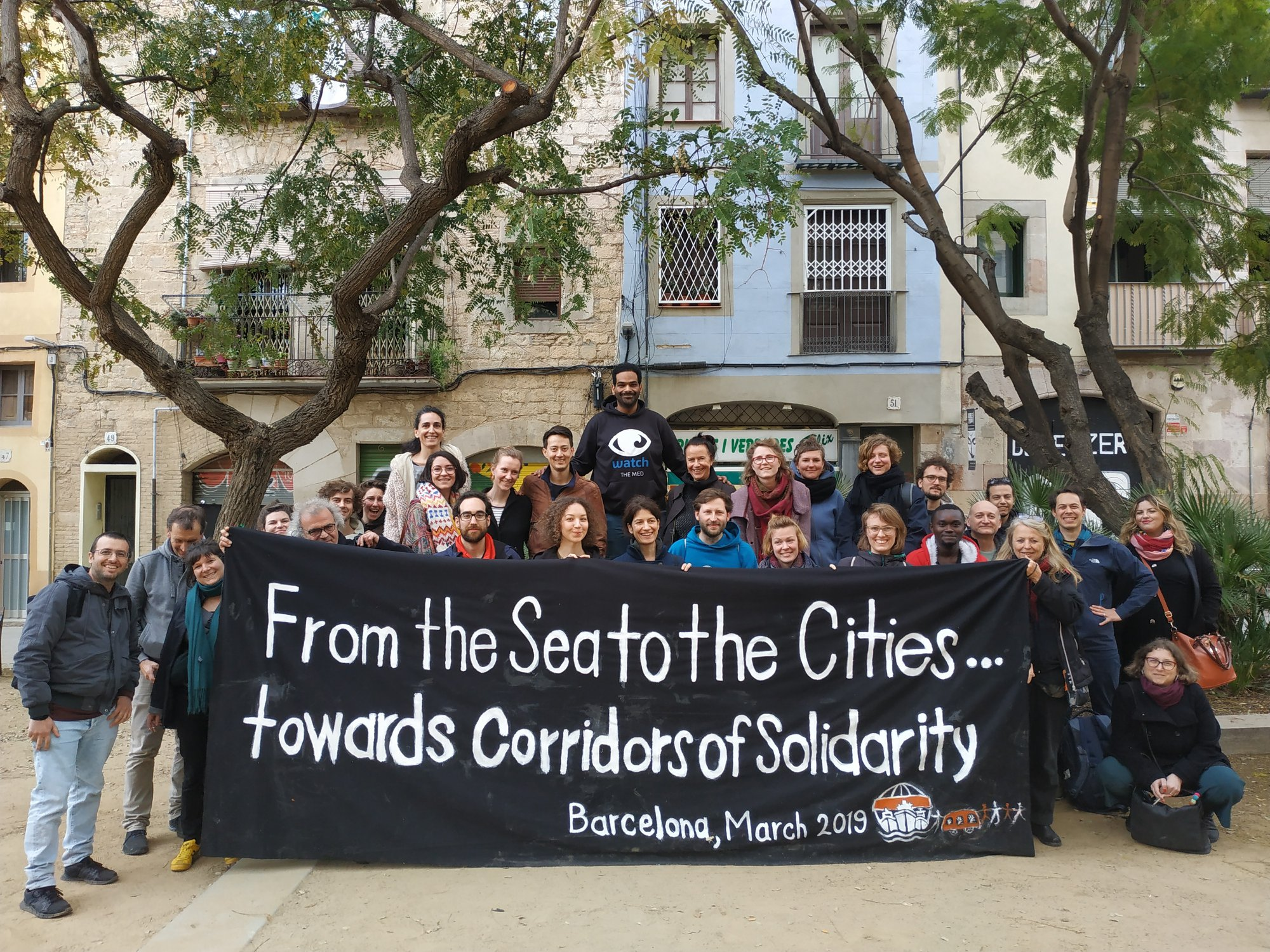Group of people behind a banner in Barcelona