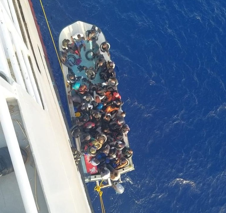 Picture from above shows people being rescued onto TALIA